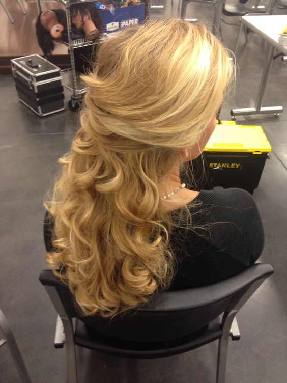 Beautiful half updo. I criss crossed the sides and curled the remaining hair. Very elegant and beautiful