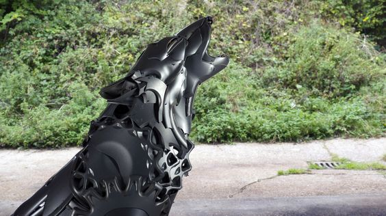 Wolf made from hubcaps at The Wing Gallery in Wadhurst TN5 6AA - 8th til 23rd May. Hubcap Creatures