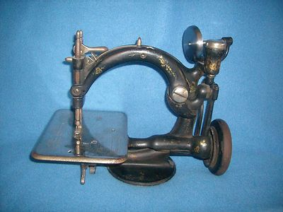 Antique 1870s Wilcox and Gibbs sewing machine.