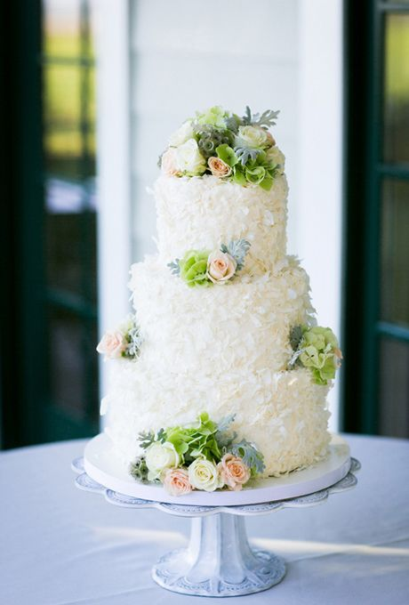 Brides.com: 32 of the Prettiest Floral Wedding Cakes. Three-tiered textured wedding cake with fresh roses, dusty miller, and hydrangeas, by Fleur de Lisa.  See more spring wedding cakes.: