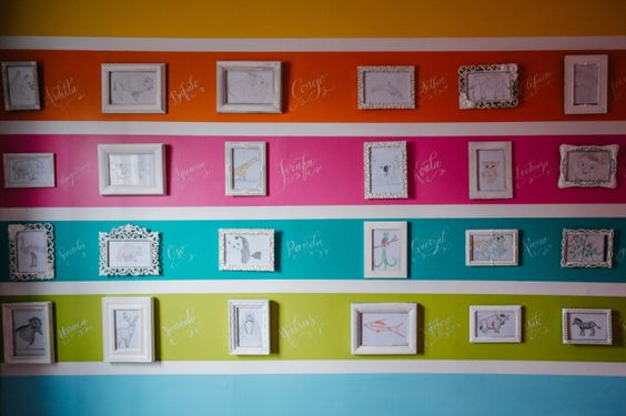 Colorful Striped Walls in Latina-Styled Nursery - Project Nursery