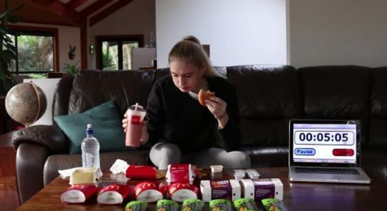 Watch This Competitive Eater Demolish 10000 Calories Worth Of McDonald's In 30 Minutes -  Watch This Competitive Eater Demolish 10000 Calories Worth Of McDonald's In 30 Minutes Inspired by another competitive eater and the Australian olympian Sawan Serasinghe Nela Zisserconsumes oneBig Mac oneQuarter Pounder twoMcChickens two hamburgers fortyMcNuggets eight sweet and sour dipping sauces sixlarge french fries six brownies onestrawberry banana smoothie and one bottle of water. Damn. Fecha…