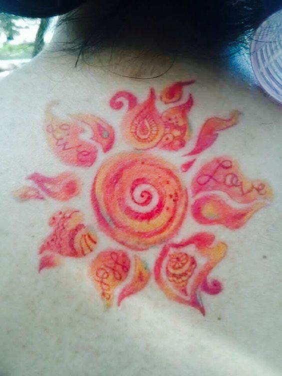 a birthday gift that would last a lifetime - my paisley sun watercolor tattoo.