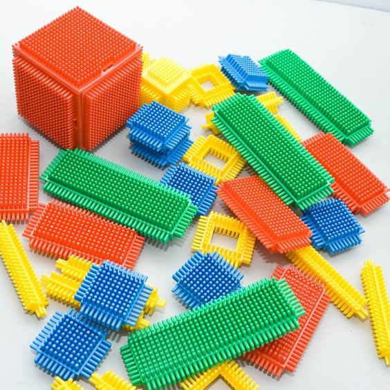 Playskool Bristle Blocks.  Yeah, I chewed on 'em and pulled the little spiny things off, but build things with them?  That's just absurd.