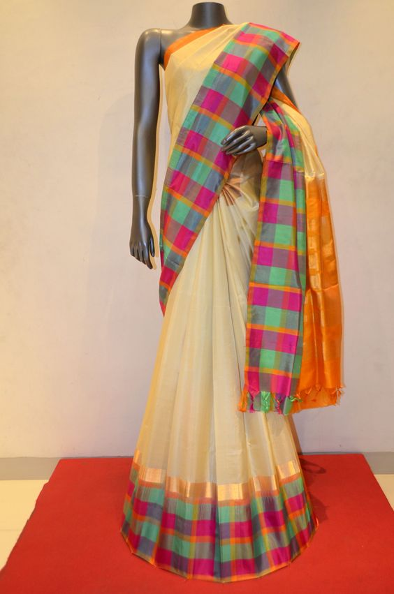 Cream Classic Soft Silk Saree With Colorful Checks With Zari Border Product Code: AB212645 Online Shopping: http://www.janardhanasilk.com/index.php?route=product/product&search=AB212645&description=true&product_id=4068