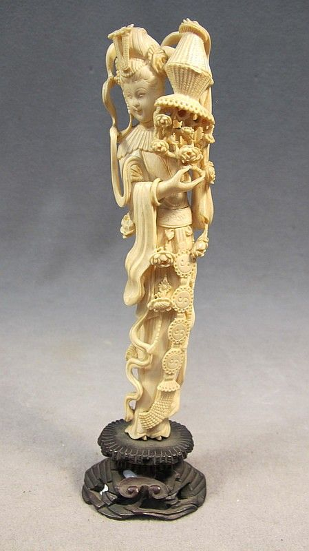 """Chinese carved ivory fig. of Guanying Chinese hand carved ivory fig. of Guanying on a wood base. 7 7/8"""" x 2"""" W x 1 5/8"""""""