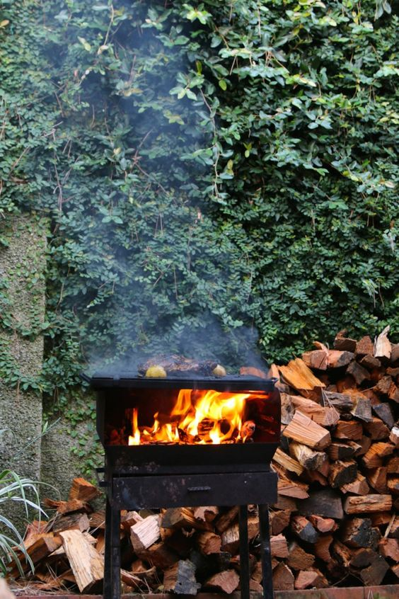 Outdoor Fireplace Stove in Summer Courtyard Garden in Italy
