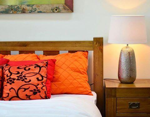A country furniture design, made of OAK WOOD, enhanced with bright cushions and a silver side lamp available only in Archipelago Furniture Showroom in Al Barsha 2 Dubai. #westerndesignfurniture #qualitysatisfaction #solidwood #Dubai #MyDubai #AbuDhabi #UAE #Oman