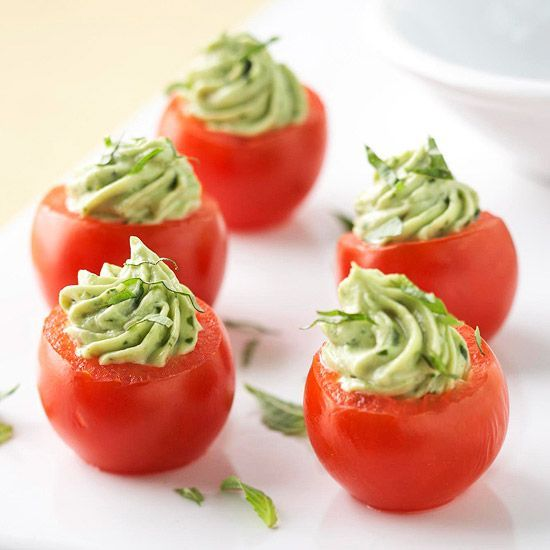 Avocado Pesto-Stuffed Tomatoes- Fresh cherry tomatoes are filled with a flavorful mixture of avocado, cream cheese, and pesto for a delicious, bite-sized appetizer.