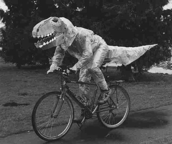 Dinosaur on a bike.