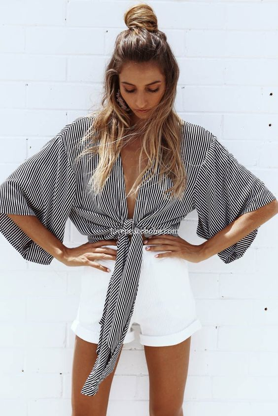 A crop top featuring an all-over stripe print, open front with self-tie bow, butterfly sleeves and relaxed fit. - Material: Cotton & Polyester Blend - Length: Cropped - Pattern: Striped Size Chart (Measurements in cm) 2.54 cm=1 inch Size Bust Shoulder Waist Length S 88 54 84 58 M 92 55 88 59 L 96 56 92 61 XL 100 57 96 62