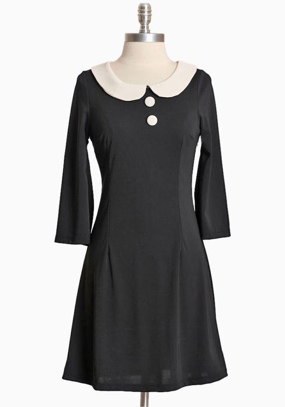 """Maybelline Buttoned Dress 34.99 at shopruche.com. Simple and sophisticated, this tailored black dress is detailed with decorative cream accents, three-quarter length bell sleeves, and a back zipper closure. Finished with a hint of stretch for a comfortable and flattering fit.  100% Polyester, Made in USA, 34"""" length from top of shoulder"""