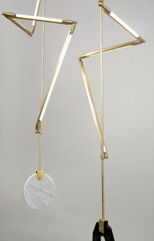 The HELIX is a continuation of Brittains exploration of bars of unobstructed light, begun in her SHY light series. Custom brass hardware and LED tubes wrap around a central support. A stone counterweight anchors the piece in space and adds the softness of craft in an otherwise stark structure.
