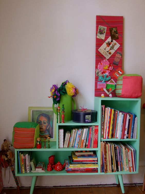 I found this bookshelf in a second hand shop, took the doors off & painted it...At 4 years old A.  takes her reading very seriously.