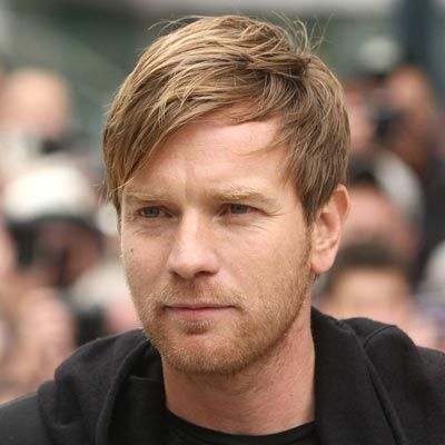 This cool angled cut is another way to conceal a high forehead whether it's always been that way or is due to a receding hairline. Ewan McGregor's indie-inspired cut grows bangs longer and wears them across the forehead at a diagonal.