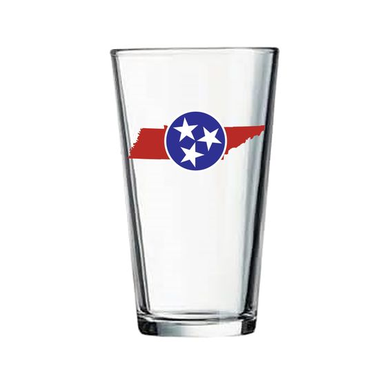 Show your pride of the Tennessee Tri-Star with this Blue & Red, 16 oz pint glass!  Blue Tri-Star over top of a Red outline of Tennessee. Durable glass, dishwasher safe, and Made in the USA. Perfect to show your Tennessee Pride! #MyTennessee $13.95