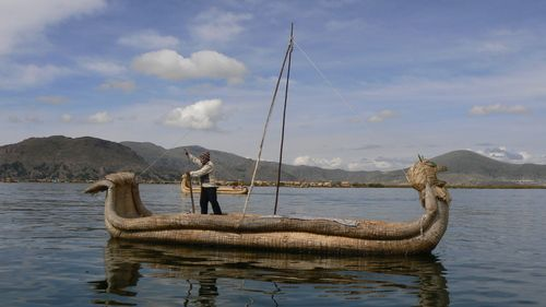 The Uros use the totora reed, which is plentiful along the edges of the lake, to make their homes, their furniture, their boats, and the islands they live on. This boat is made from reeds.
