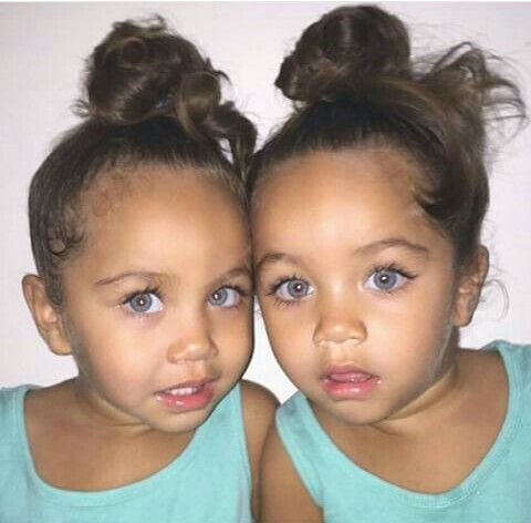 Cute lil angels! Twins or sisters? Kind of like Ann and I