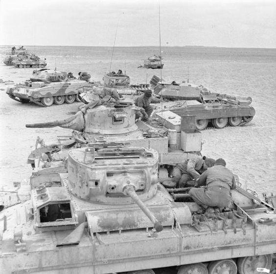 BRITISH ARMY NORTH AFRICA 1942 (E 22739) Newly-arrived Royal Armoured Corps troops working on a variety of tank types at a training camp near Abbasia in Egypt, 2 March 1943. In the foreground are a Valentine and Stuart tank, with Crusaders and more Valentines behind. On the right is a Covenanter tank, perhaps the only example of its kind to have arrived in North Africa.