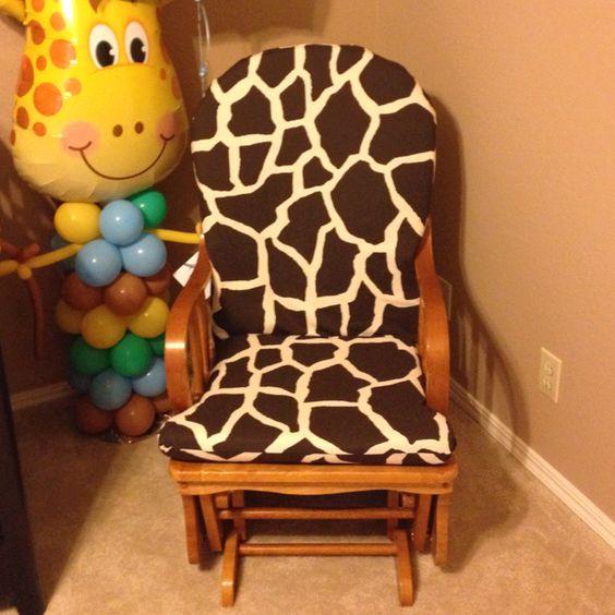 Giraffe print glider in baby boy nursery