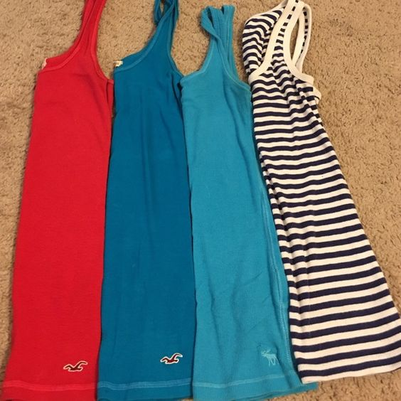 Tank top lot! Four tank tops! All in great shape. Blue one has two small white spots as shown. Hardly even noticeable and perfect to layer. First two are hollister XS, third is Abercrombie XS and last is gap S! Will not separate, not interested in it! Will take reasonable offers! Usually around $20 each Hollister Tops Tank Tops
