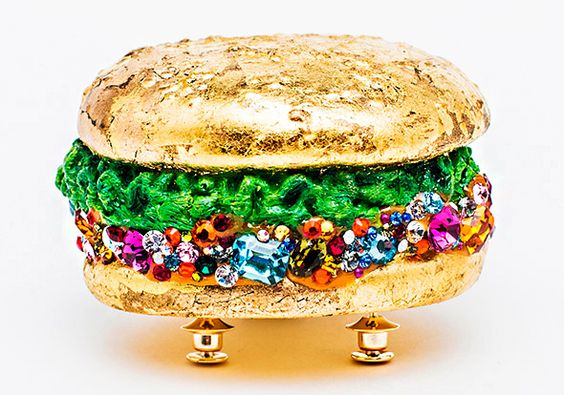 "Reka-Lörincz  ""Too Much is Not Enough"" hamburger brooch 2013 - gold plated copper, plastic, gold foil, swarovski crystal"