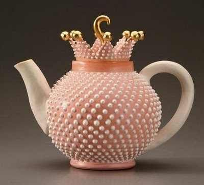 Coral Colored Milkglass Teapot. The detailed dots add texture to the teapot and also introduce a lighter colour