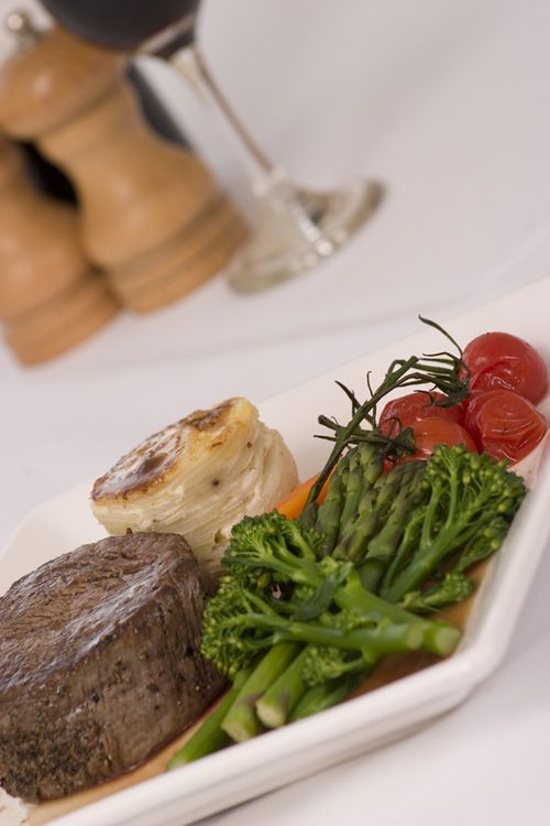 Rare braised steak Beef dish with potato fondant, roasted vine tomatoes & steamed broccoli. #event #catering #food