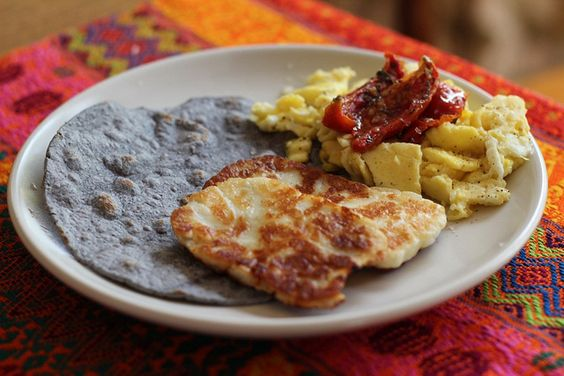 favorite breakfast: scrambled eggs with oven roasted tomatoes, grilled halloumi cheese and a blue corn tortilla.