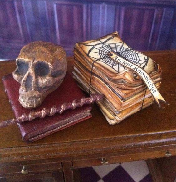 Ancient Set Dollhouse Miniature, Large Leather Book, Skull, Wand, Thick stack of papers 'Ancient Knowledge' label, 1inch scale by PetiteUniques on Etsy https://www.etsy.com/transaction/1042628685