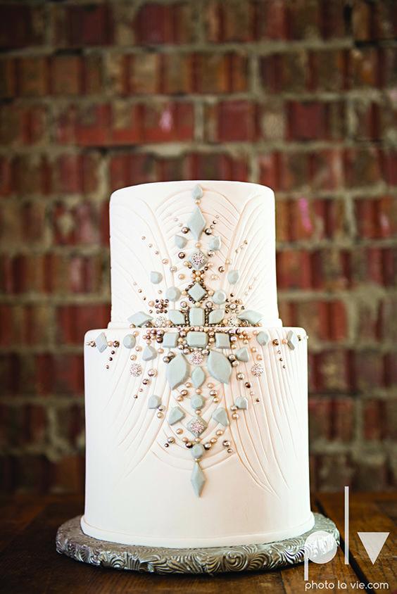 Gatsby Wedding Cake. http://photolavie.com http://cremedelacremecatering.com jewels stones gray white 2-tier gem vintage modern design center symmetrical focus