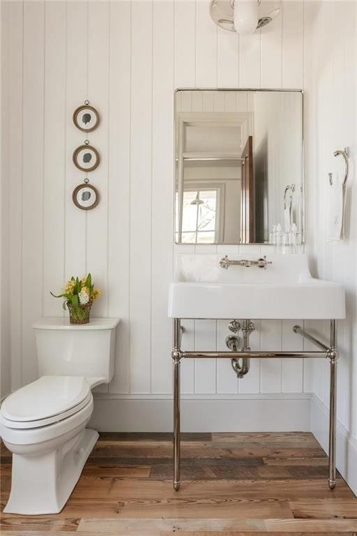 Recreating the Look of an Old Farmhouse in Kansas - Hooked on Houses #farmhouse #bathroom #pedestalsink