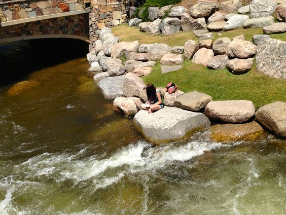 ...found a warm spot to read - Gore Creek in Vail