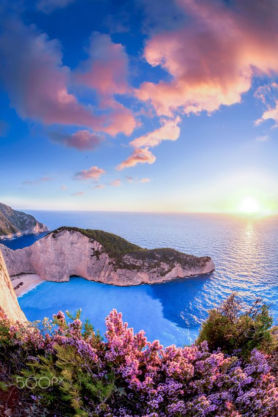 Navagio beach with shipwreck against sunset on Zakynthos island in Greece - Navagio beach with shipwreck against sunset on Zakynthos island in Greece
