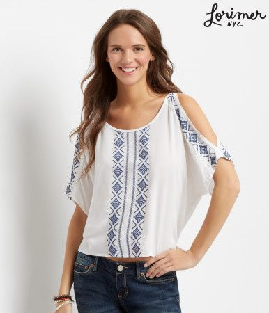 "A brand new sunrise means a fresh opportunity to show off this Lorimer Cold Shoulder Peasant Top! The front and sleeves are accented with Southwest embroidery, while shoulder cutouts finish this rustic-chic style.<br><br>Relaxed fit. Approx. length: 22""<br>Style: 4366. Imported.<br><br>100% rayon.<br>Machine wash/dry flat.<br><br>Model height: 5'10""; Size: Small."