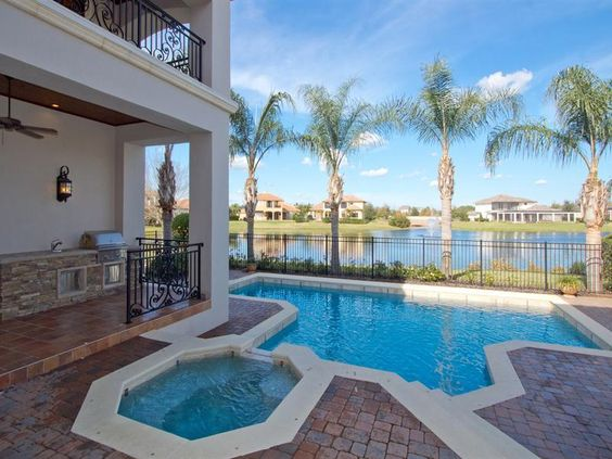 Gorgeous pool overlooking water . I want this house!  www.findinghomesinhenderson.com #realestate