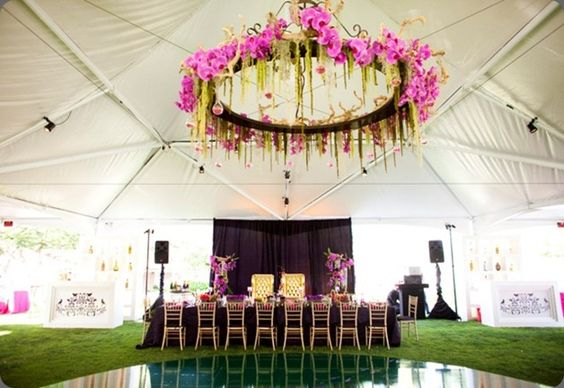 make smaller to hang from tree to add floral accents to frame where we are standing......floral chandelier over dance floor