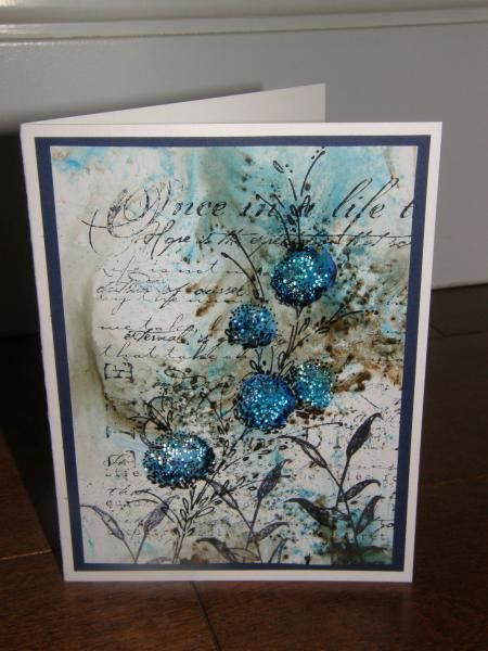 """By calex at Splitcoaststampers. Uses stamp from Penny Black """"Delicate Florals"""" set along with text and background stamps of unknown origin."""