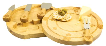 """Size: 9""""D x 1.5""""H Passionate about poker? Dreaming of a royal flush? Our charming Eco-Friendly Engraved Poker Chip Cutting Board With Cheese Accessories is the perfect addition to your kitchen!  There's no need to bluff about your chef skills, because this cutting board with cheese accessories is just what you need to show of your suave talents in the kitchen. Made with rich and vibrant bamboo, this chopping board is sure to impress. The cutting board is sculpted to mirror the design…"""