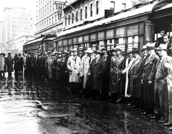 Crowds gathered in the rain by street cars - Jacksonville, Florida, 1936; Florida Memory