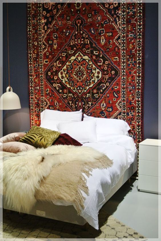 Persian rug as wall hanging - bohemian bedroom