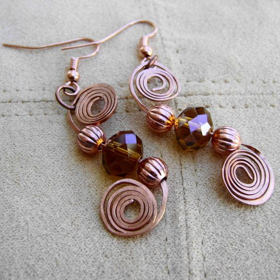 My friend Joanne's amazing work.  Copper and Czech Glass Wire Wrapped Spiral by MoonlightAndFire- previous pinner