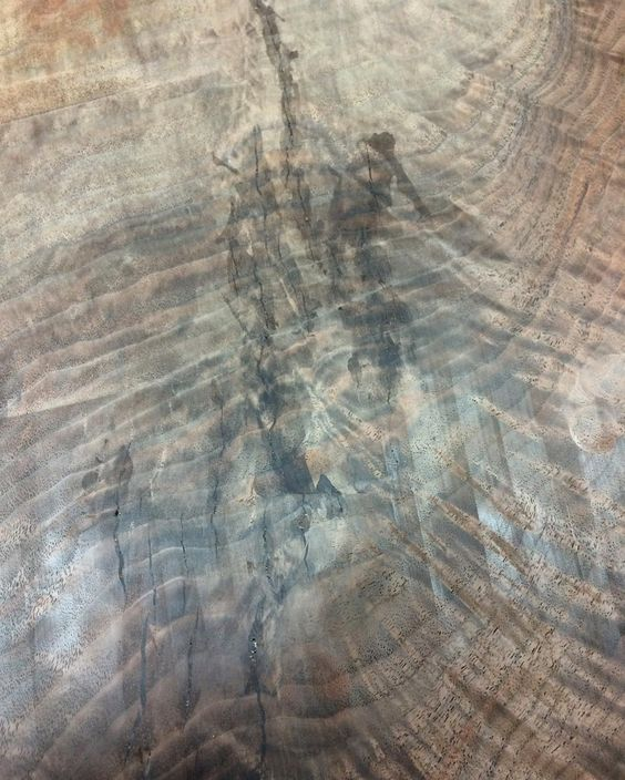 This is a prime example of why I'm not crazy about the epoxy fill. It's tough to limit how much gets absorbed around the cracks to be filled. Maybe carefully waxing around the voids would work. Lots of sanding coming up http://ift.tt/1OFFk5Y