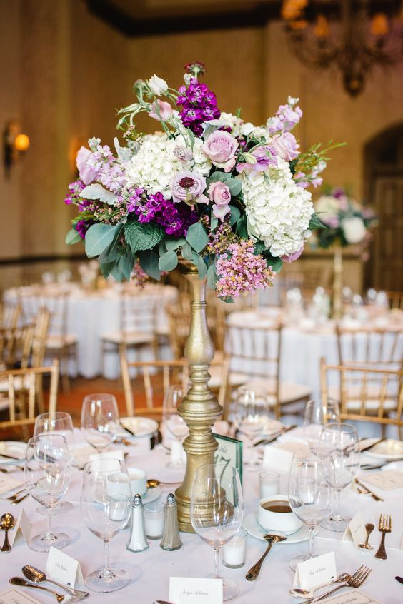 Wedding reception centerpiece of white hydrangea lavender