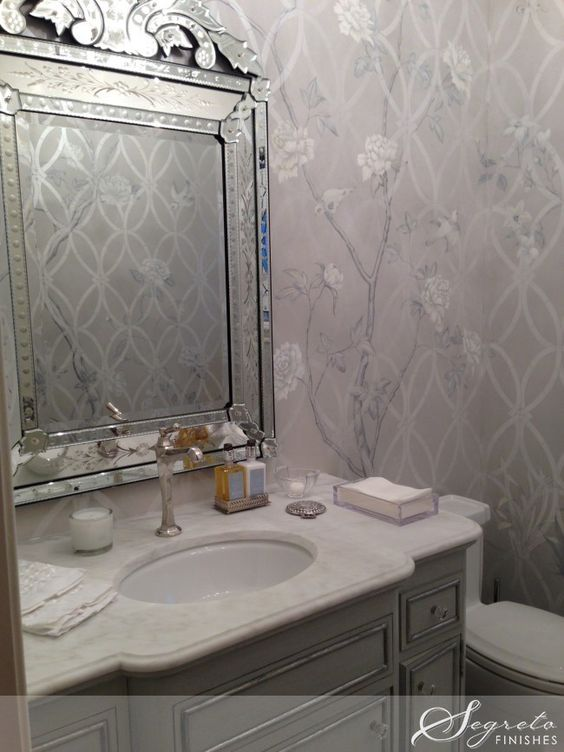 Bianco Bella Marble from Sweeny Marble Co., Houston.  Segreto's Stenciling on the plastered walls. cabinet painted with a silver leaf detail. Knobs by Acero Bella.   Accessories Longoria Collection Houston.