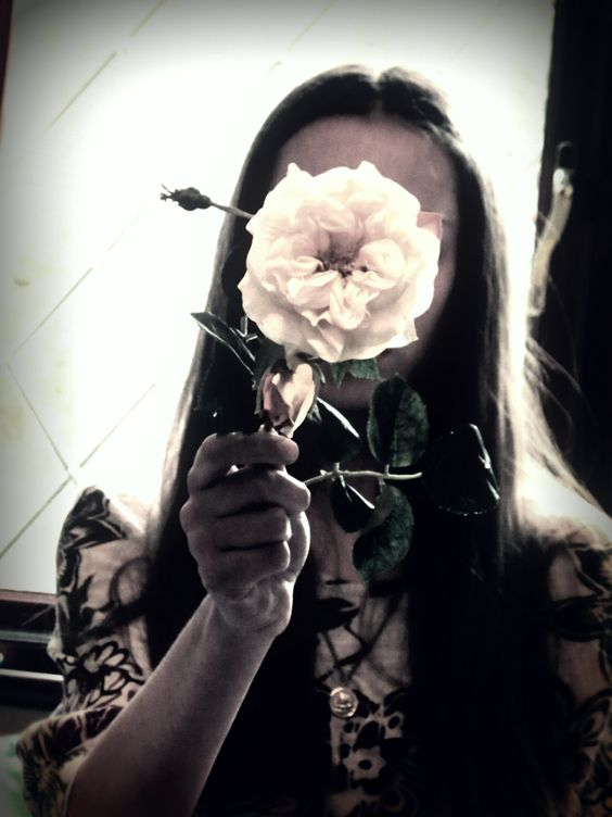 Day 21: Faceless self portrait. Hidden by a yellow rose. By Phthalo Green