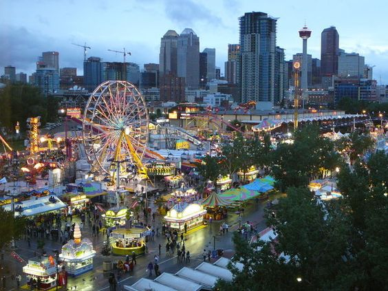 Calgary during the annual Calgary Stampede. Never have I seen an entire city so enthusiastic from the time land in Calgary airport until you leave. so friendly and fun too :)