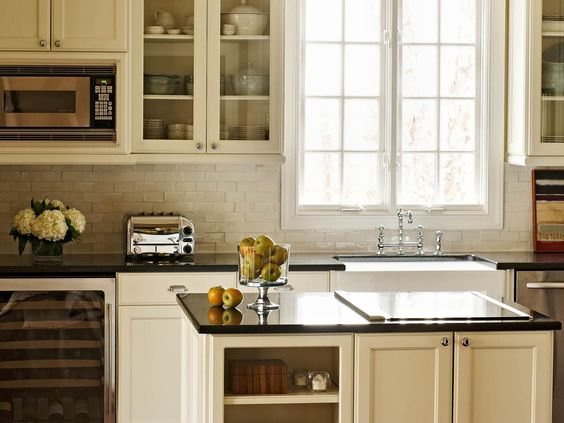 Beautiful dinnerware displayed in glass-front cabinets add color ...