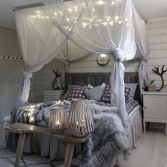 Bohemian style bedroom for teen with lots of curtain and string lights finished with faux fur beddings