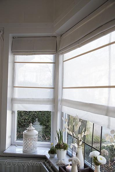 Window treatment for bay windows double layered roman for Blinds for bay window